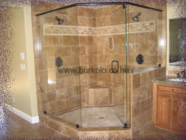 Az épített zuhanyzó üvegfala a mennyezetig ér így a szellőztetés egy bukó szekezettel lett megoldva